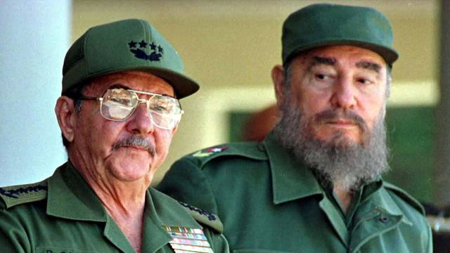 FILE PHOTO: Fidel Castro and his brother Raul Castro preside over a ceremony in Havana, Cuba