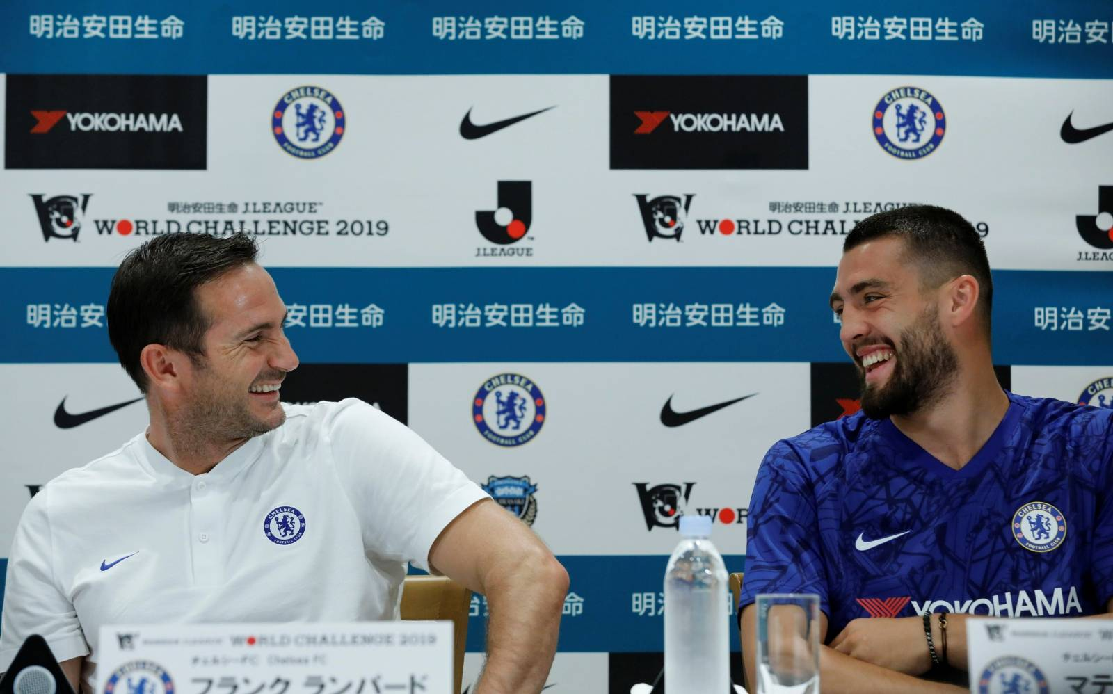 Chelsea manager Frank Lampard laughs with his player Mateo Kovacic during a news conference ahead of their pre-season match against Japan's Kawasaki Frontale in Yokohama