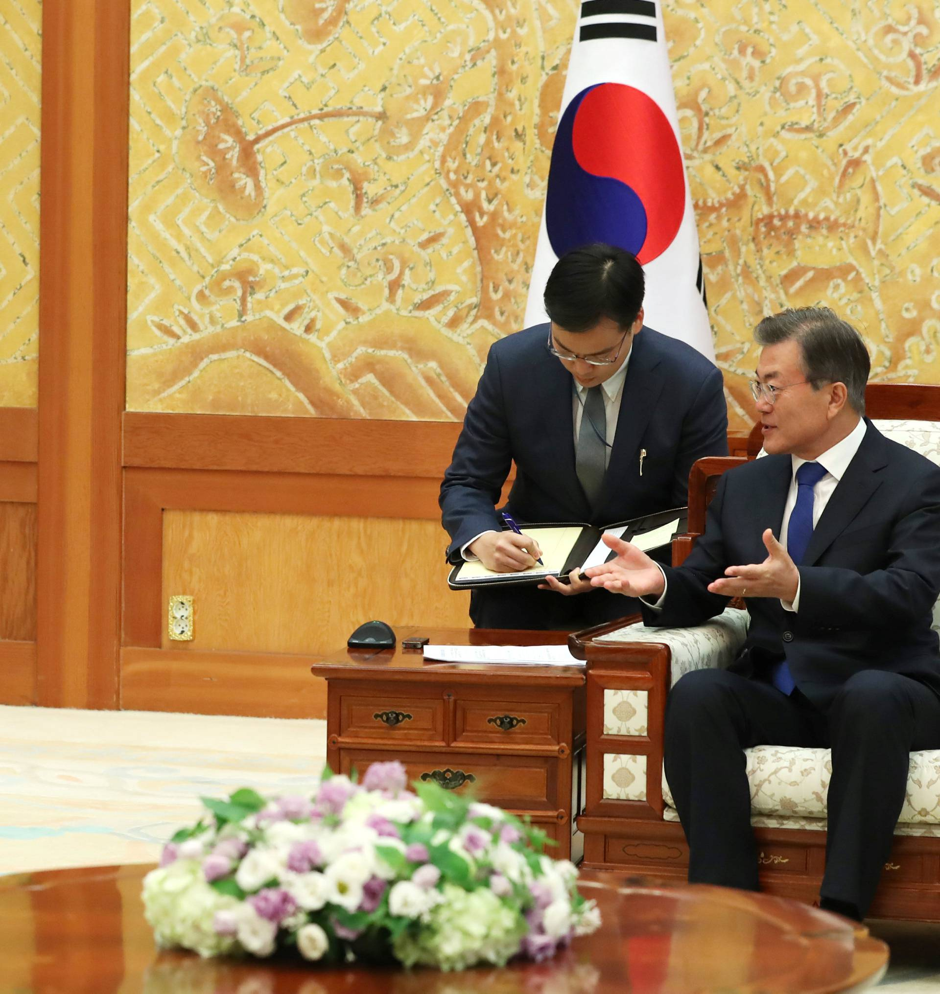 South Korean President Moon Jae-in talks with U.S. Chairman of the Joint Chiefs of Staff Gen. Joseph Dunford during their meeting at the Presidential Blue House in Seoul
