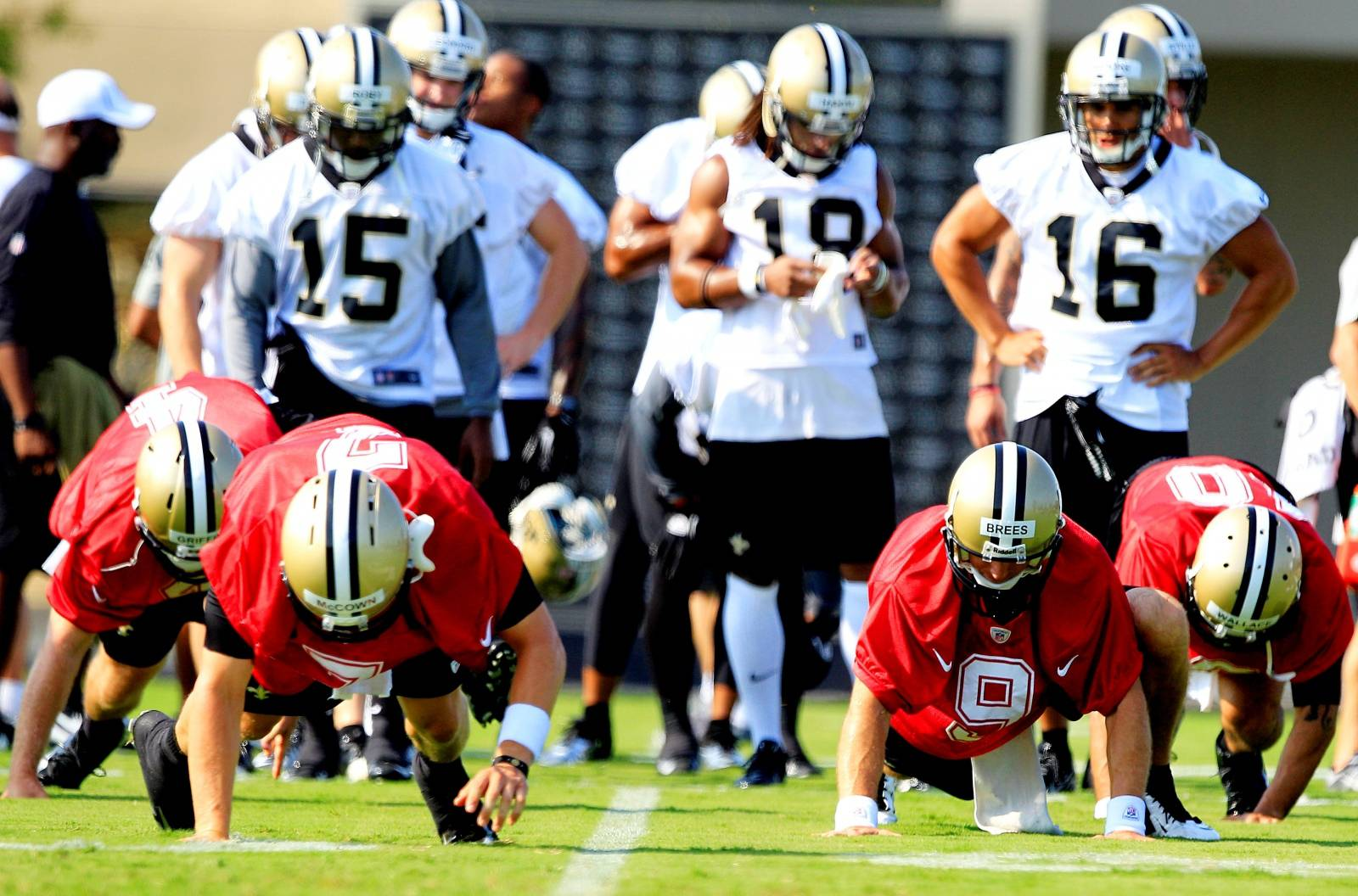 FILE PHOTO: New Orleans Saints players work out during a NFL training camp in Metairie