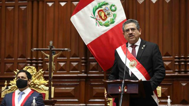 Peru's interim President Manuel Merino addresses lawmakers at Congress after he was sworn in following the removal of President Martin Vizcarra, in Lima