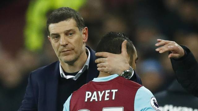 Manchester United manager Jose Mourinho gestures as West Ham United's Dimitri Payet hugs West Ham United manager Slaven Bilic after he is substituted off