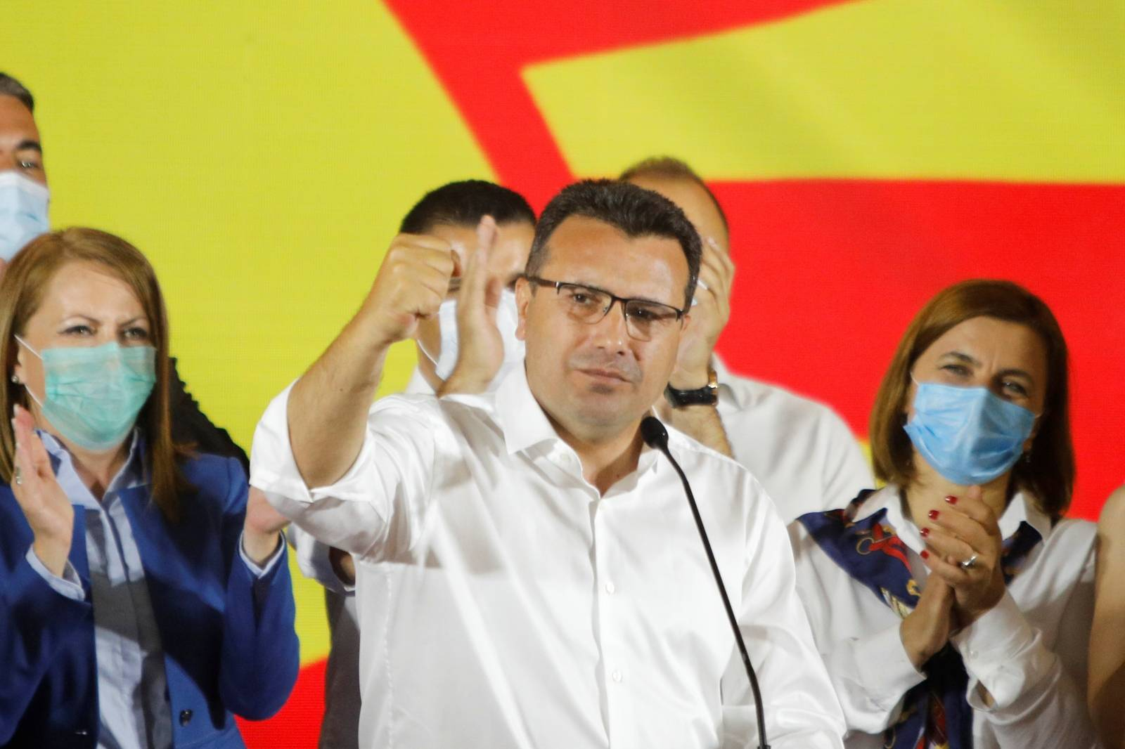 Macedonian Former Prime Minister and leader of the ruling SDSM party Zoran Zaev celebrates his victory in a parliamentary election in Skopje