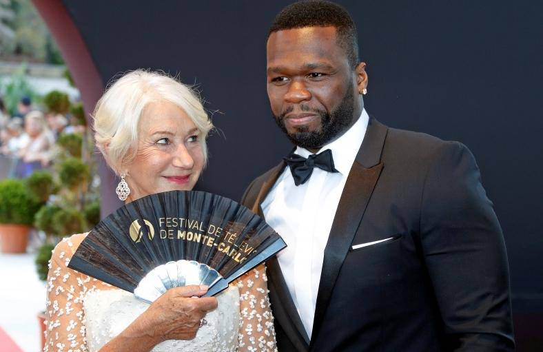 "Actor Mirren poses with actor and singer ""50 Cent"" before the closing ceremony of the 57th Monte-Carlo Television Festival in Monaco"