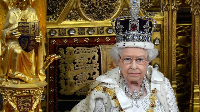 FILE PHOTO: Britain's Queen Elizabeth waits before delivering her speech in the House of Lords, during the State Opening of Parliament at the Palace of Westminster in London