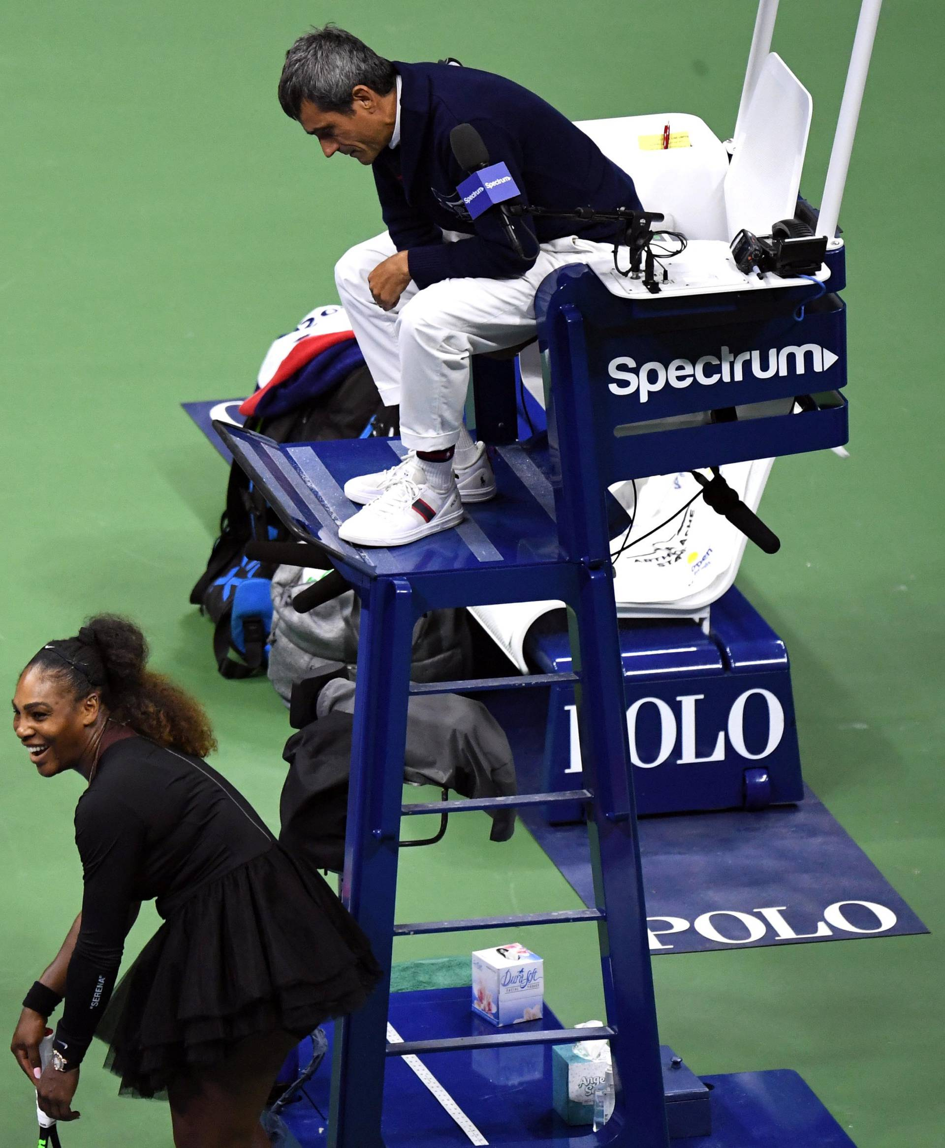 FILE PHOTO:  Osaka of Japan, Williams of the United States, and chair umpire Ramos talk after Ramos charges Williams with a game penalty in New York