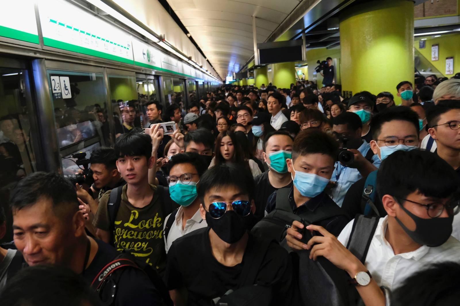 Anti-extradition bill demonstrators block a Mass Transit Railway (MTR) train in Hong Kong