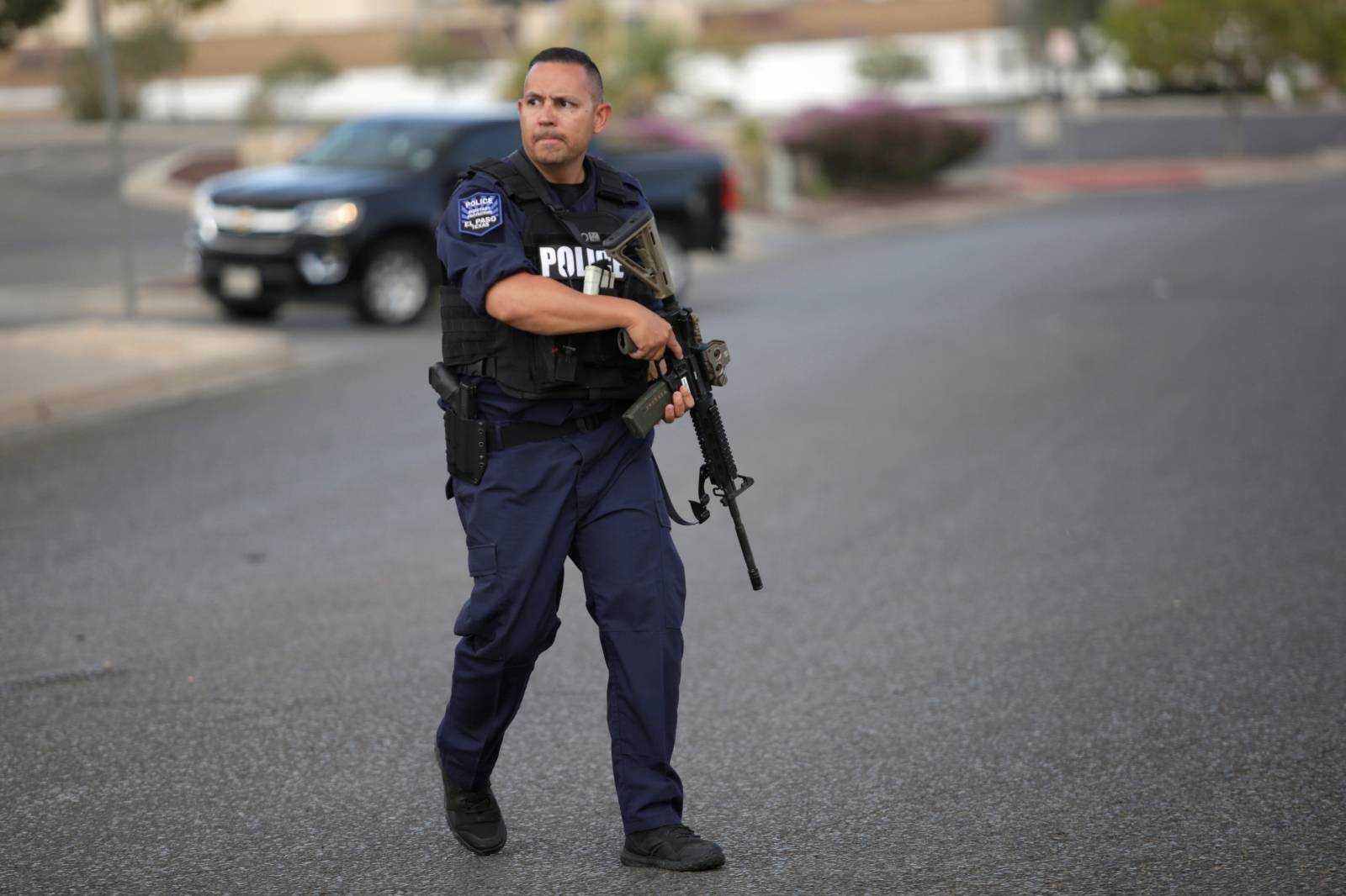 A police officer is seen after a mass shooting at a Walmart in El Paso