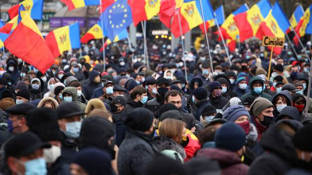 Supporters of Moldovan President-elect Maia Sandu attend a rally to demand the government to resign and to hold early parliamentary elections in Chisinau