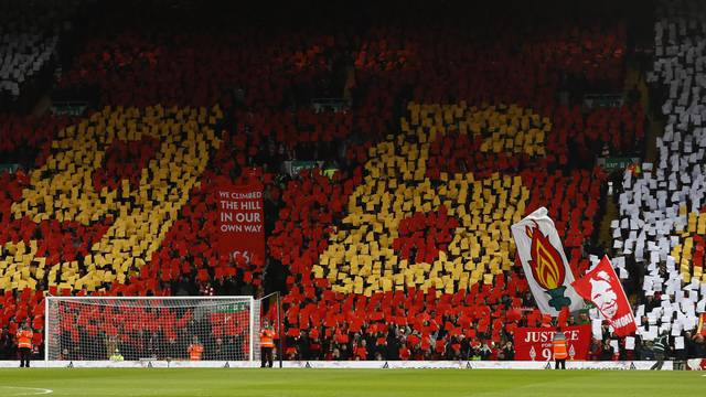 General view of players and fans during a minutes applause in memory of the Hillsborough disaster victims