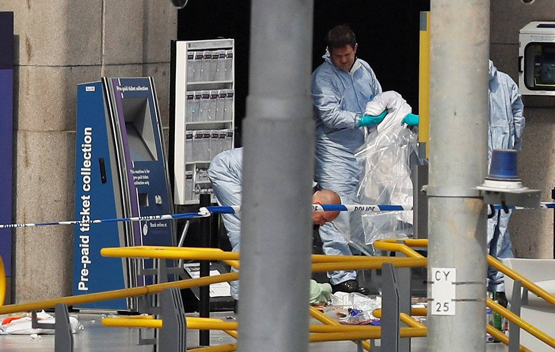 Forensics investigators work at the Manchester Arena in Manchester