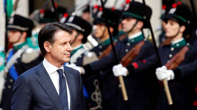 Italy's Prime Minister Giuseppe Conte reviews the guard of honour at Chigi palace in Rome
