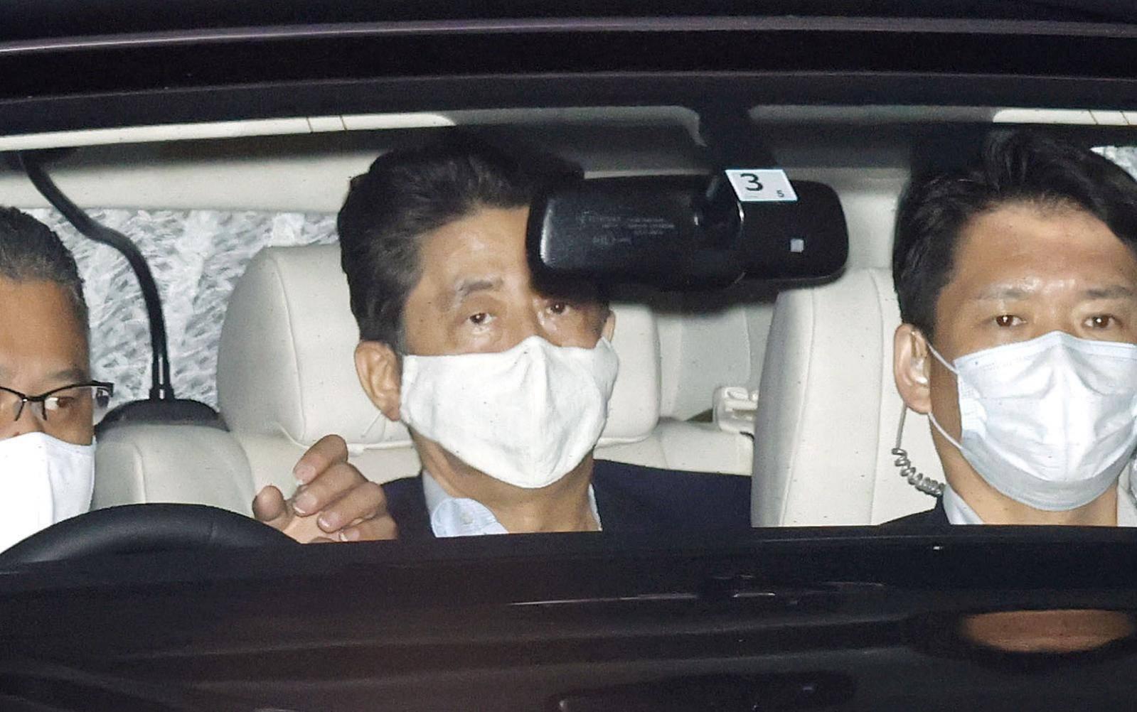 Japanese Prime Minister Shinzo Abe arrives at his residence as he returns from Keio University Hospital in Tokyo