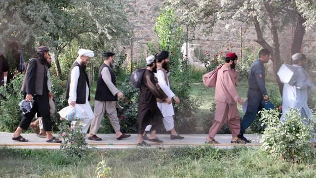 Newly freed Taliban prisoners walk at Pul-e-Charkhi prison, in Kabul