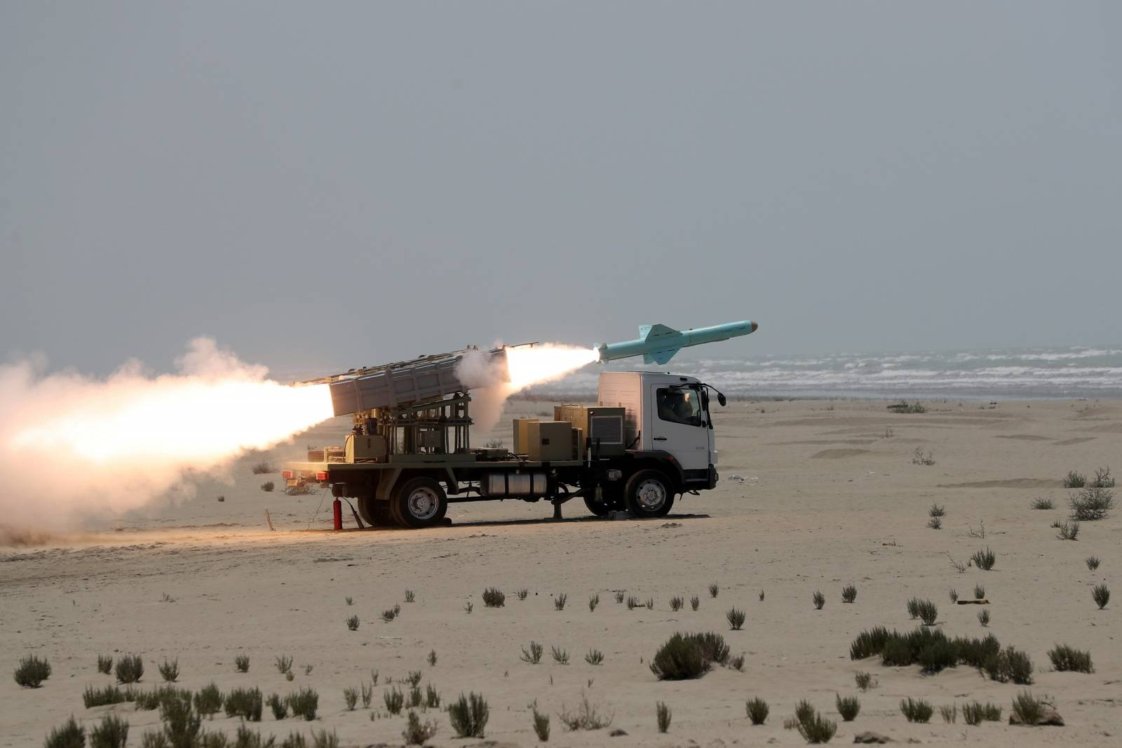 An Iranian locally made cruise missile is fired during war games in the northern Indian Ocean and near the entrance to the Gulf