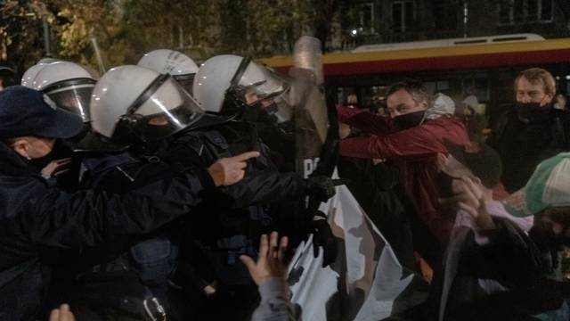 Police scuffle with people near the house of Law and Justice leader Jaroslaw Kaczynski during a  protest against imposing further restrictions on abortion law in Warsaw