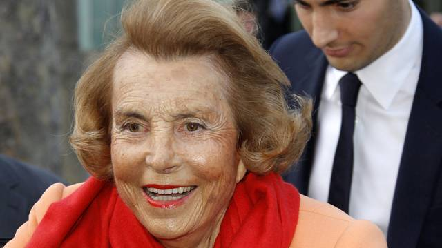 FILE PHOTO: Liliane Bettencourt, heiress to the L'Oreal fortune leaves with Jean-Victor Meyers, her grandson, the L'Oreal-UNESCO prize for women in Paris