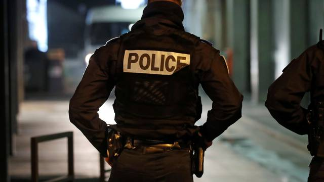 French police secure an area at La Defense business and financial district near Paris