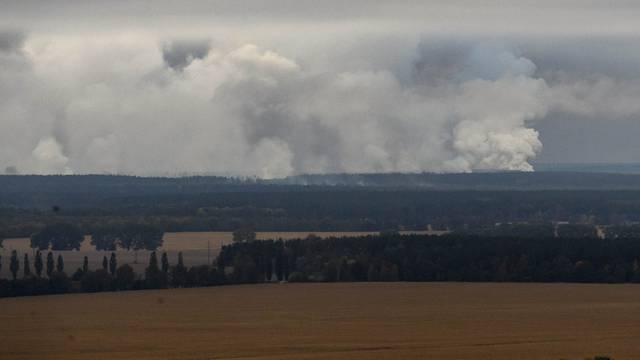 Smoke rises after a fire and explosions hit the Ukrainian defence ministry ammunition depot in the eastern Chernigov region