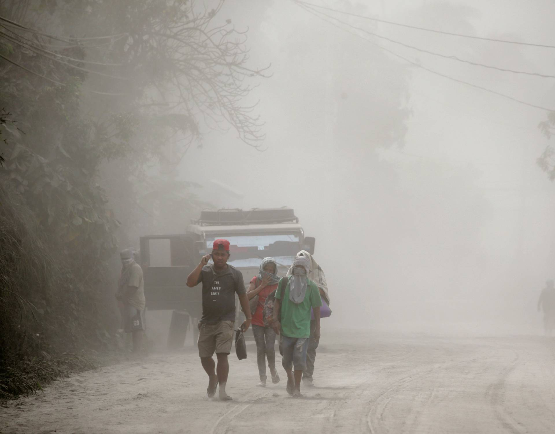 Residents living near the erupting Taal Volcano evacuate Agoncillo