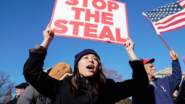 """People participate in a """"Stop the Steal"""" protest outside the U.S. Supreme Court in support of U.S. President Donald Trump in Washington"""