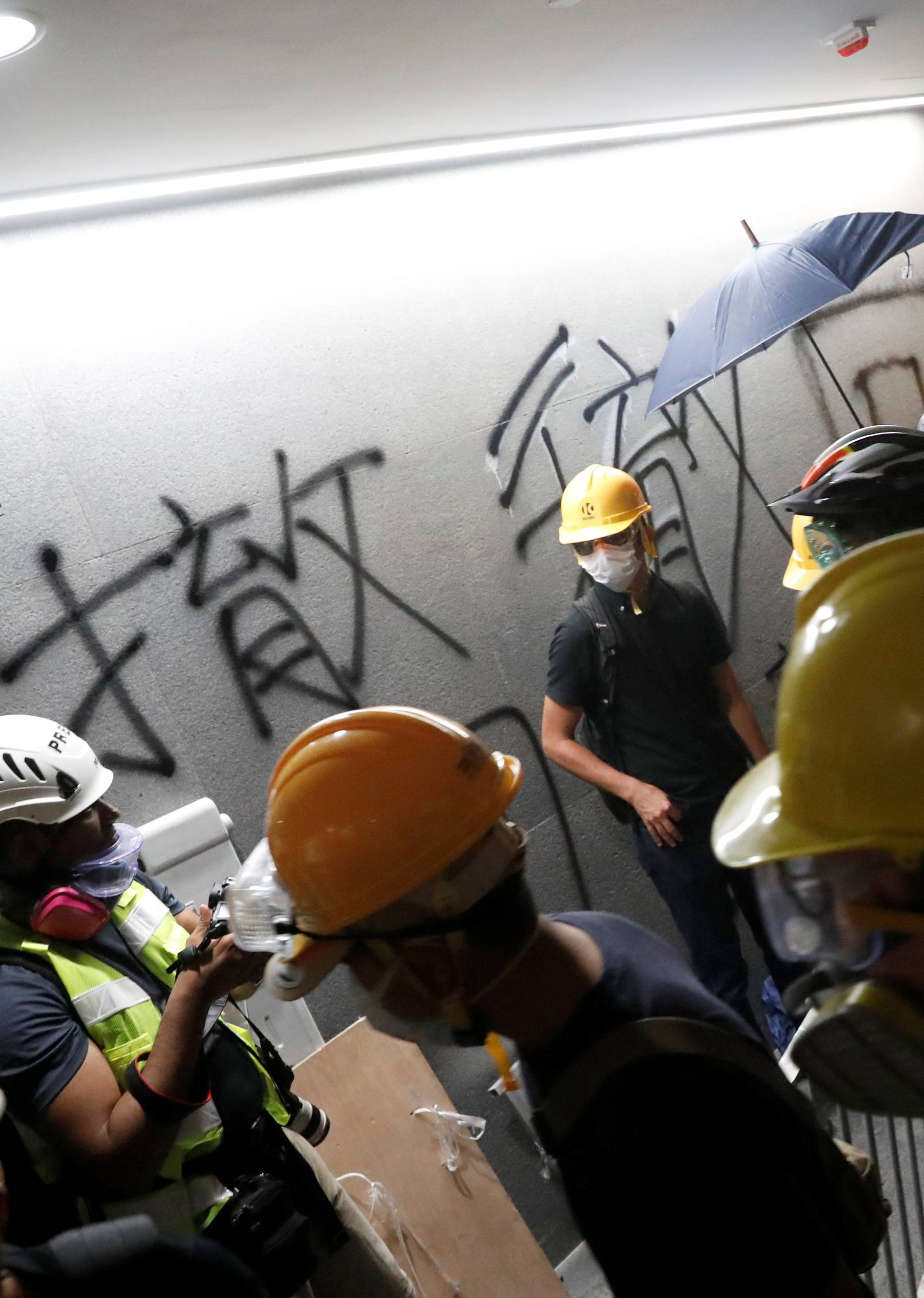 Protesters break into the Legislative Council building during the anniversary of Hong Kong's handover to China in Hong Kong