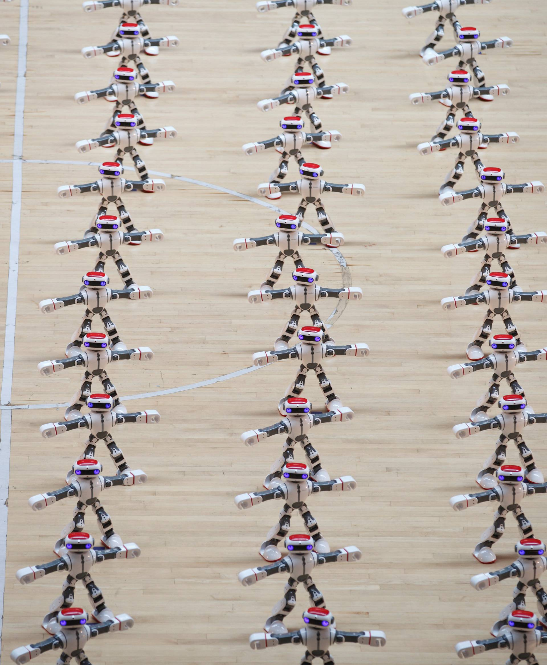 Robots perform dancing during a robot contest in Dezhou