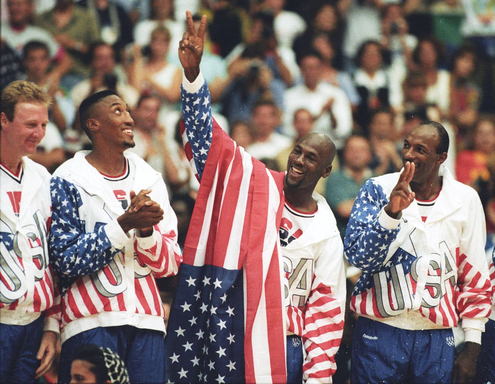 FILE PHOTO: U.S. basketball player Michael Jordan flashes a victory sign as he stands with team mates Larry Bird, Scottie Pippen and Clyde Drexler after winning the Olympic gold in Barcelona