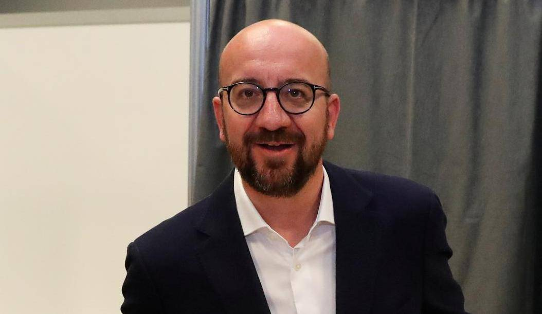 Belgian Prime Minister Charles Michel casts his vote for the Belgian general and regional elections and for the European Parliament Elections in Limal