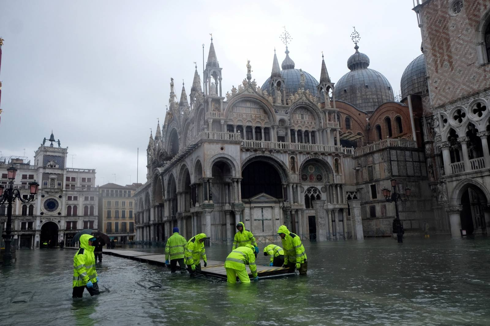 FILE PHOTO: Workers put up a platform at a flooded St. Mark's Square in Venice