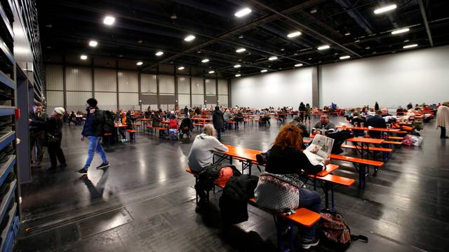 Residents wait in exhibition hall after downtown was evacuated in Augsburg