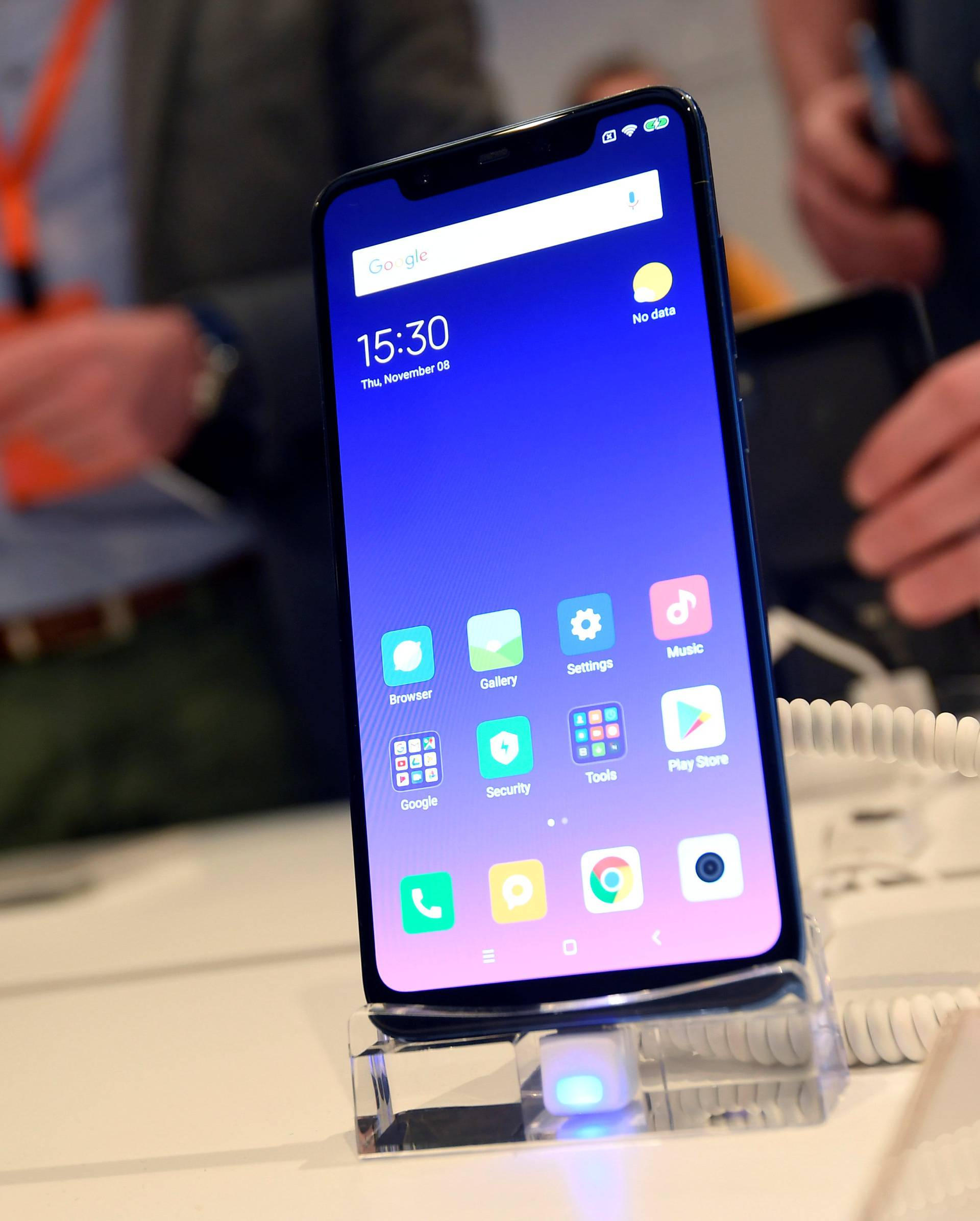 Guests view the Xiaomi Mi 8 smartphone at a UK launch event in London