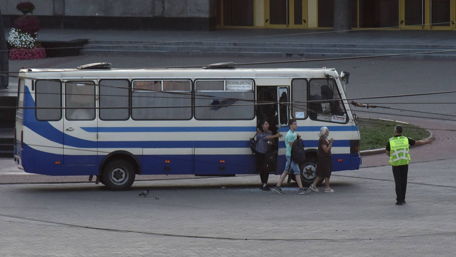 Three hostages walk out of a seized passenger bus in Lutsk