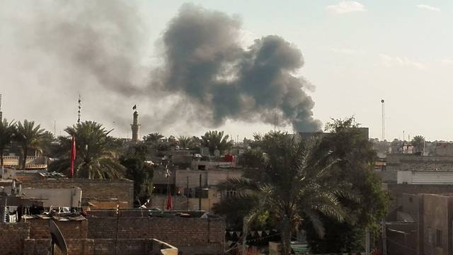 Smoke rises from the site of a suicide car bomb attack at a used cars dealers parking in Hayy al-Shurta, neighborhood in southern Baghdad