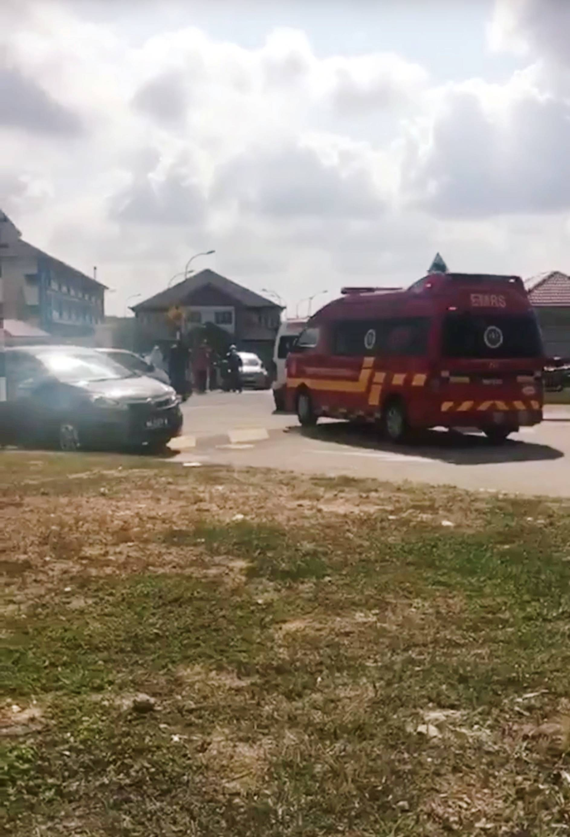 An ambulance enters a primary school after following a suspected chemical leak last week in Pasir Gudang