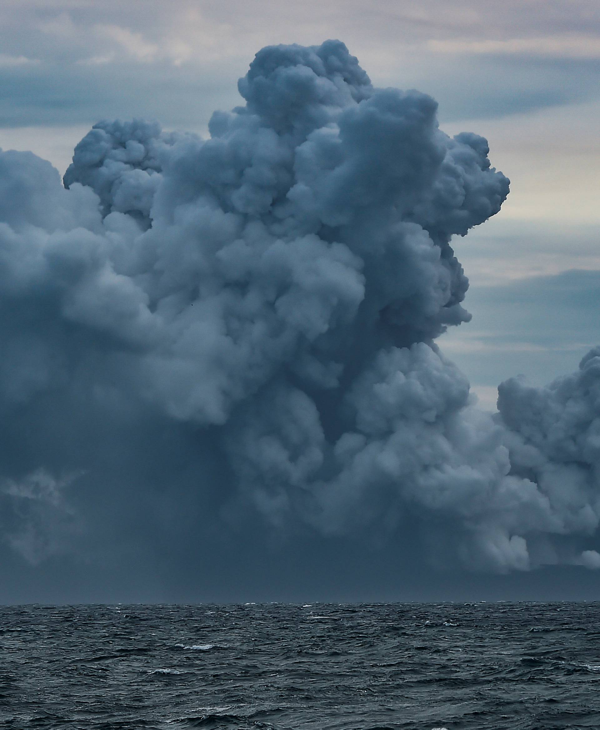 Mount Anak Krakatau volcano spews hot ash during an eruption as seen from Indonesian Naval Patrol Boat, KRI Torani 860, at Sunda strait in Banten
