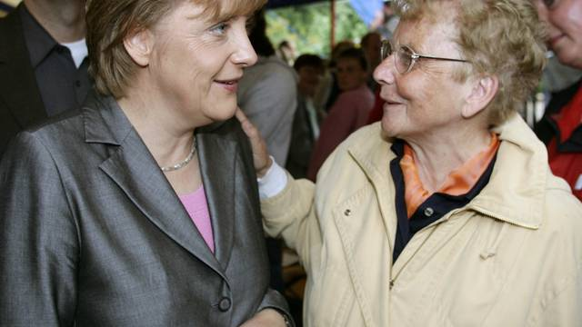 FILE PHOTO: Conservative challenger Merkel talks to her mother Kasner during an election campaign rally in Templin