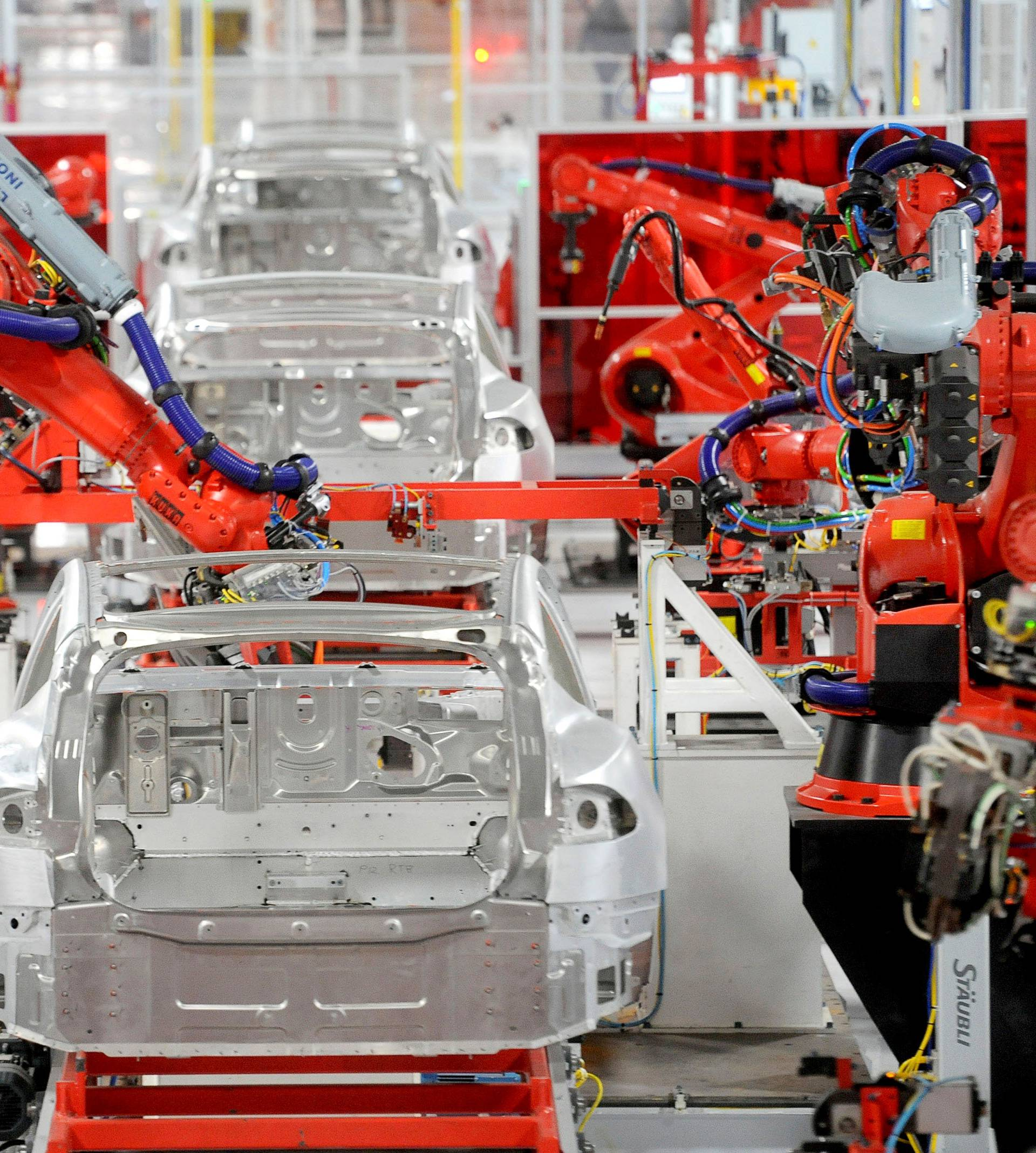 FILE PHOTO: Robotic arms assemble Tesla's Model S sedans at the company's factory in Fremont