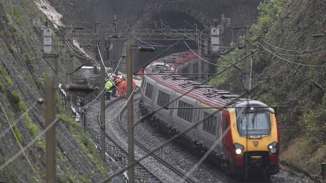 Emergency services and rail workers attend the scene of a train derailment at Hunton Bridge tunnel north of Watford Junction station