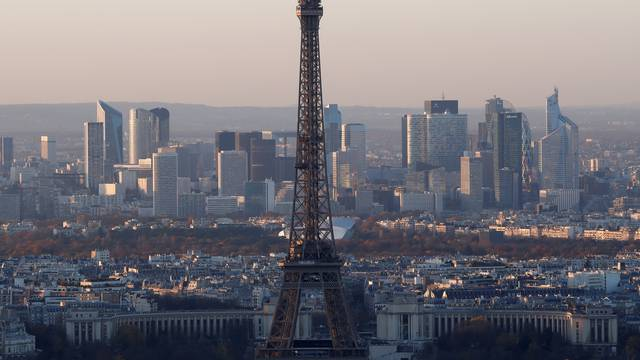 FILE PHOTO - A general view shows the Eiffel Tower and the financial and business district in La Defense, west of Paris