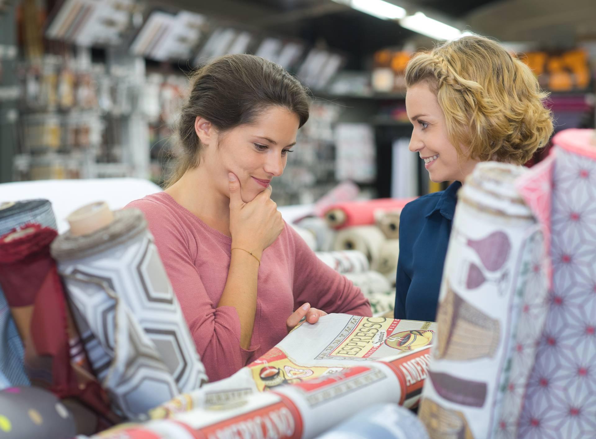 friends customers choosing carpet in housewares hypermarket