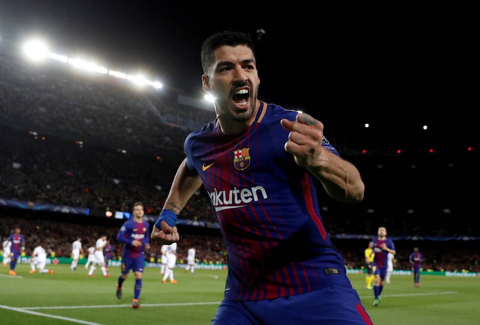 FILE PHOTO: Barcelona's Luis Suarez celebrates scoring their fourth goal in a 4-1 victory over Italy's AS Roma in the first leg of their Champions League quarter-final tie.
