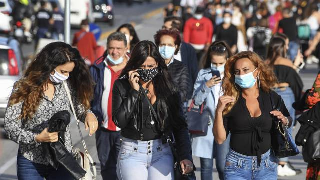 People wear face masks after the southern Italian region of Campania made it mandatory to wear protective face coverings outdoors 24 hours a day, to contain the coronavirus disease (COVID-19) outbreak