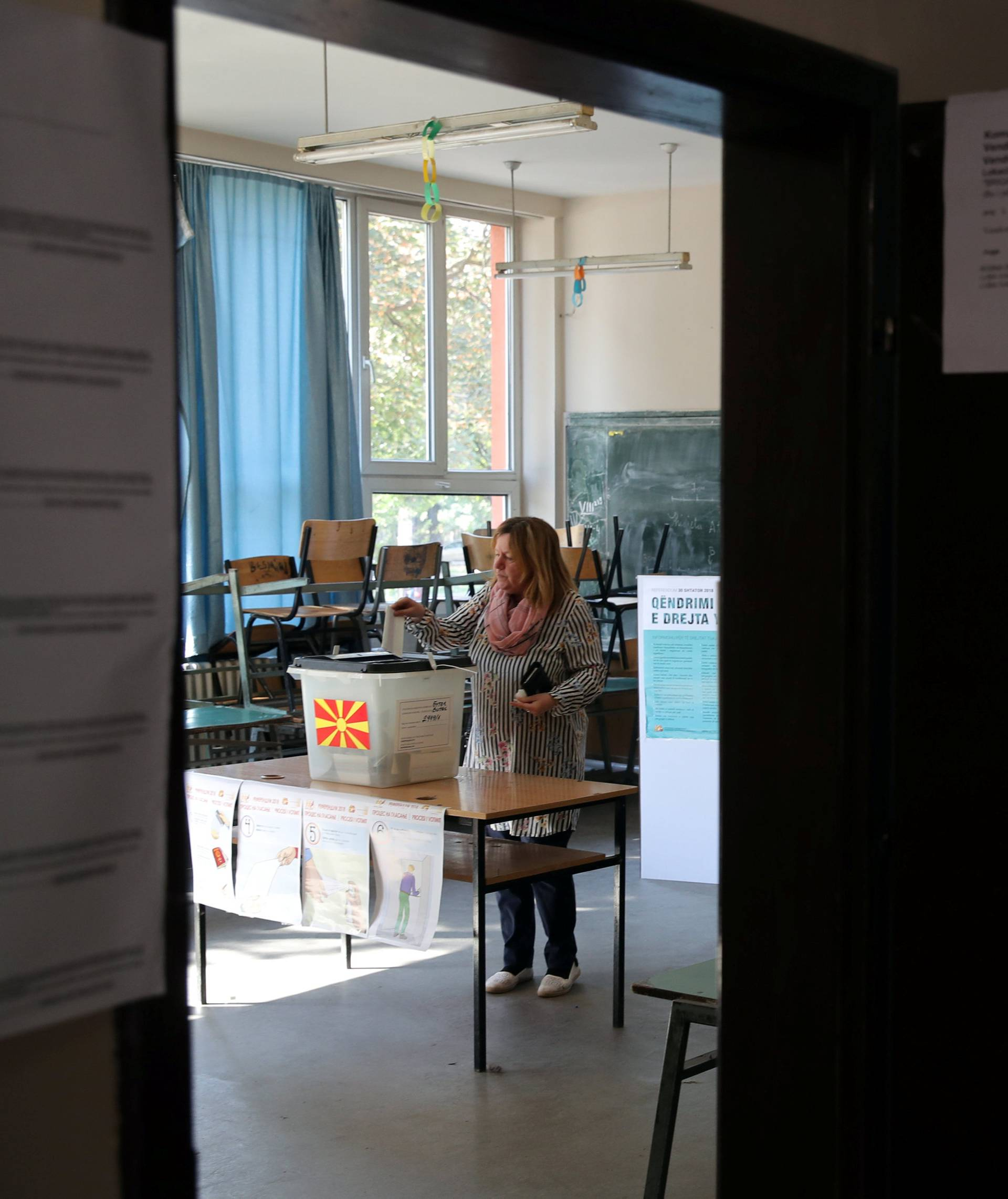 A woman casts her ballot for the referendum in Macedonia on changing the country's name that would open the way for it to join NATO and the European Union in Skopje