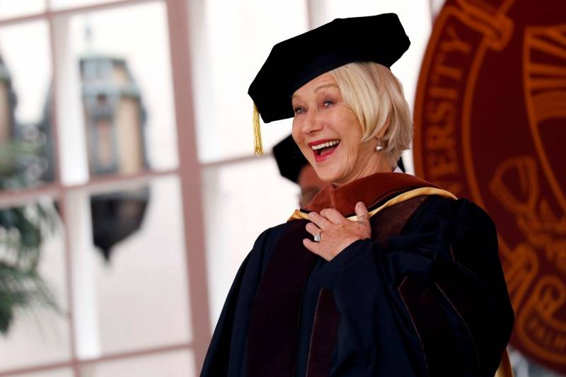 Actor Helen Mirren receives an honorary degree from USC President C. L. Max Nikias during the commencement ceremony at the University of Southern California (USC) in Los Angeles