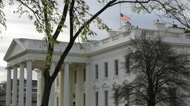 FILE PHOTO: The U.S. flag flies at half-staff at the White House in Washington