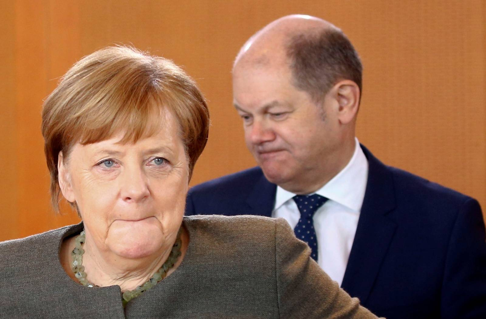 German Chancellor Angela Merkel and Finance Minister Olaf Scholz attend the cabinet meeting in Berlin