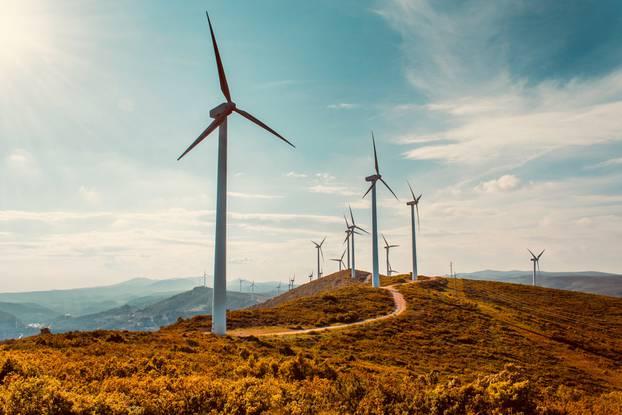 Wind,Turbines,On,Beautiful,Sunny,Summer,Autumn,Mountain,Landsape.,Curvy