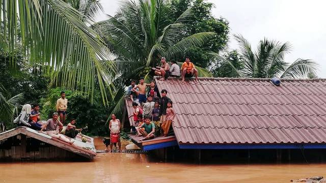 Villagers evacuate after the Xepian-Xe Nam Noy hydropower dam collapsed in Attapeu province