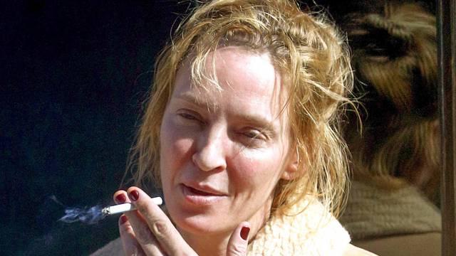 *EXCLUSIVE* Uma Thurman looks run down smoking cigarettes